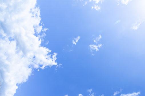 日差しと晴天の空の写真素材