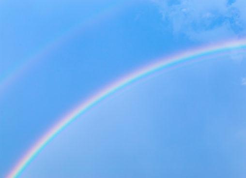 雨上がりの虹の写真素材
